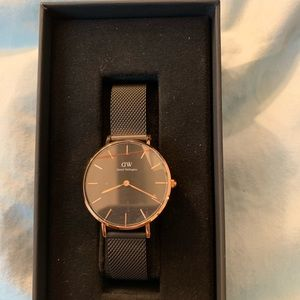 Brand new gold and black Daniel Wellington watch